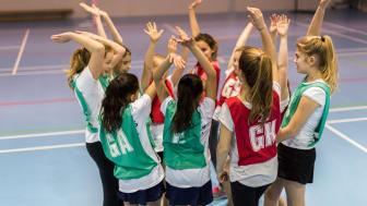 Girls playing a Netball match