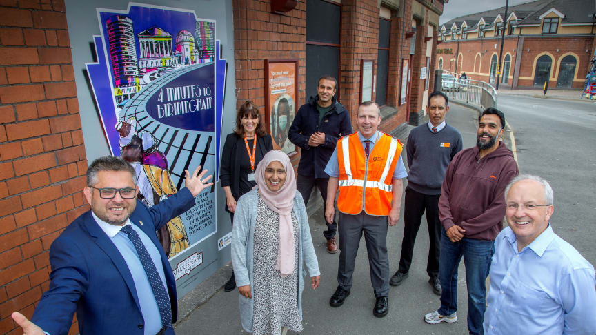 Representatives from West Midlands Railway, communities and local councillors unveil the artwork.