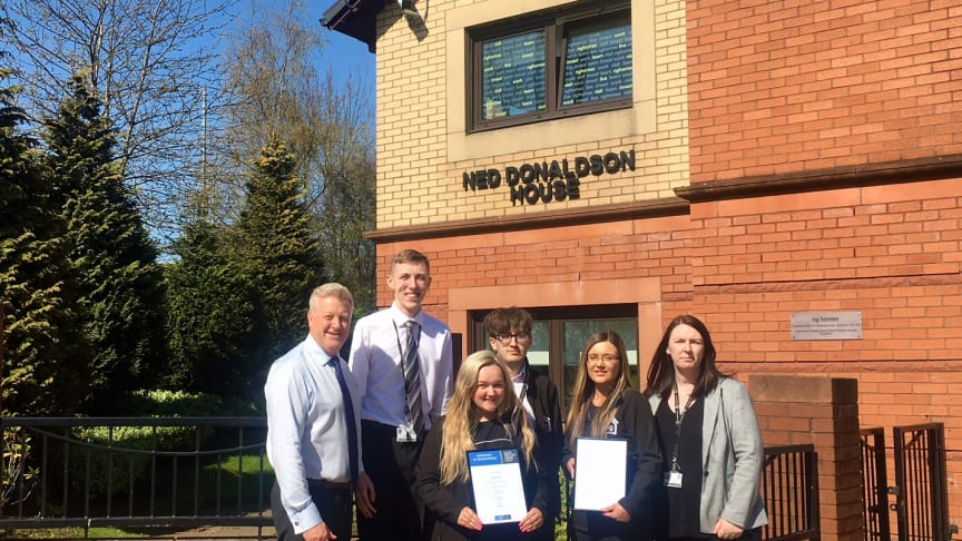 ng homes staff; Tony Sweeney, Depute Director (Corporate Services), Alan Nicolson, CSO, Lucy Brown, CSO, Connor Hazlett, CSO/Housing Assistant, Danielle Quinn, Housing Officer, Karen Johnson, Housing Manager proudly display the IIYP Gold Certificate