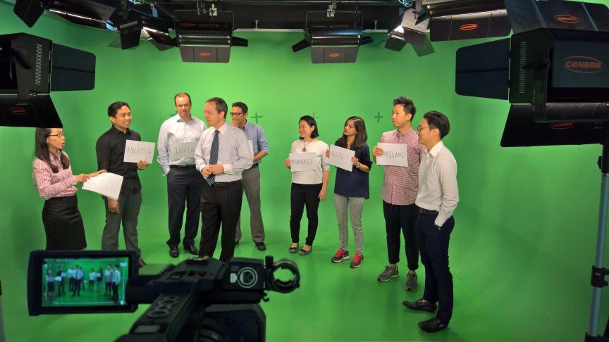 HBM's Mark Laudi and Communications Specialists on set at HBM's Kuala Lumpur studio