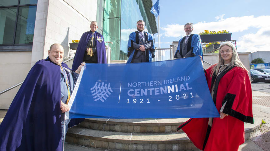 Pictured at the flag raising ceremony is members of Mid and East Antrim's NI100 Working Group.