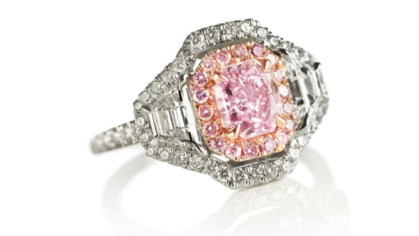 """An important diamond ring set with a natural """"fancy purplish pink"""" diamond weighing app. 1.05 ct. and """"fancy pink"""" and white diamonds, mounted in 18k pink and white gold."""