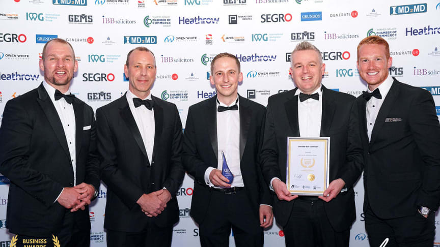 Luke Marion, Finance and Commercial Director and Andy Morison, Head of Customer Experience collect Oxford Bus Company's Best Use of Technology award at the Thames Valley Chamber of Commerce Annual Business Awards