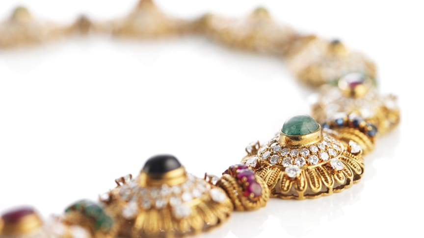 Van Cleef & Arpels' fantastic necklace of 18k gold set with facet- and cabochon-cut rubies, sapphires, emeralds and brilliant-cut diamonds.
