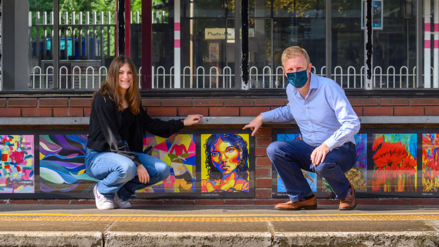 Platform paintings: Annabelle Shields, aged 14, shows Culture Secretary Oliver Dowden MP the portrait she created for Radlett station's platform gallery