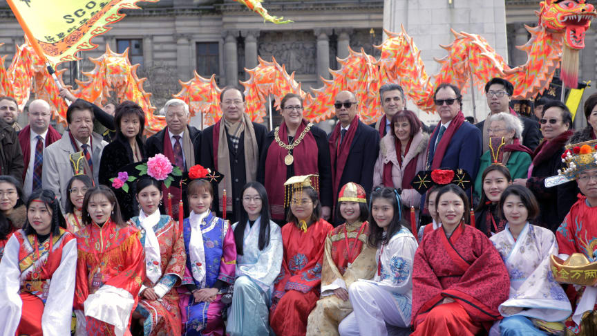 Lord Provost Eva Bolander (centre), Chinese Consul General Xinchun Pan (centre left), Chinese Cultural and Welfare Society Scotland Chairperson Andy Chung (centre right) and guests at George Square