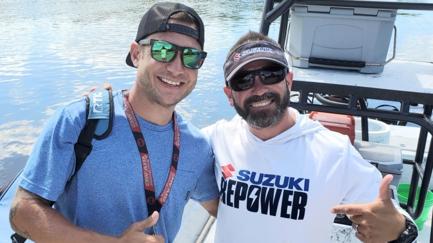 Mathew Cobb, grand prize winner of Mastry Engine Centers Owner's Edge Strike It Big Contest, with Captain Travis Yaeckel, of the Instinct Fishing Company