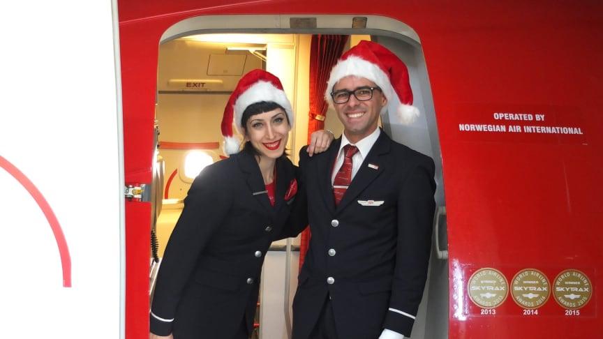 Norwegian crew welcome passengers on board