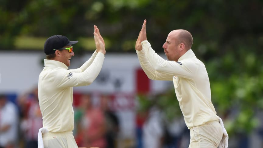 Jos Buttler (left) and Jack Leach playing for England (Getty Images)