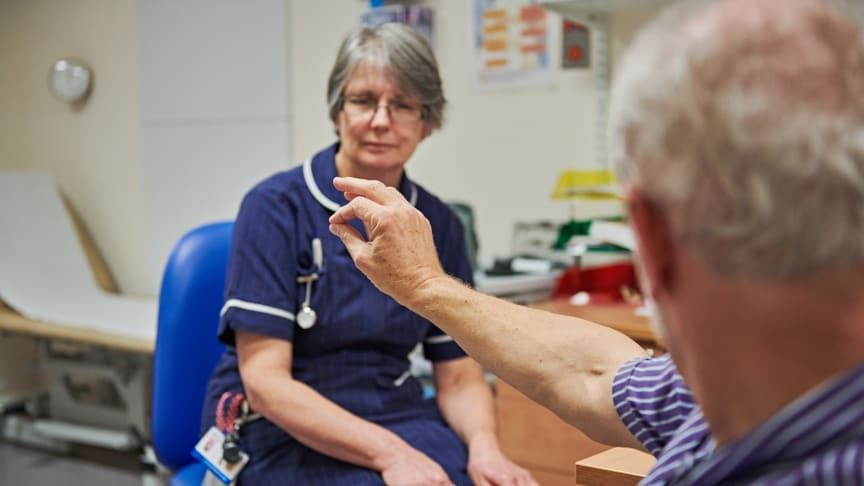 A Parkinson's Nurse working with a patient