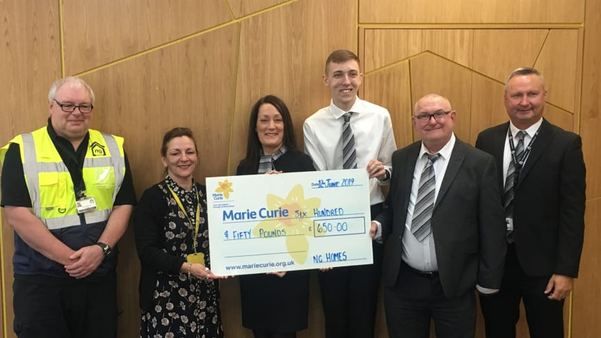 Amanda Casey, Community Fundraiser at Marie Curie receiving their cheque from ng homes staff - Concierge Gerry McDonald, Housing Manager Sharon Hazlett, CSO Alan Nicolson, Chairperson John Thorburn and Concierge & Property Manager Colin Leverage