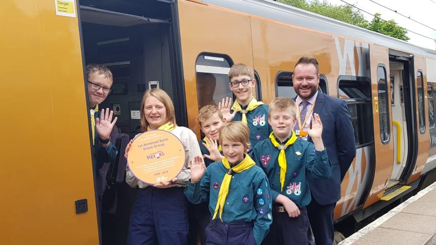 Group leader for 1st Astwood Bank Scouts, Sally Payne and area conductor manager for West Midlands Railway, Paul Cassidy, with some of the Scouts receiving their Cross City Heroes award at Redditch railway station