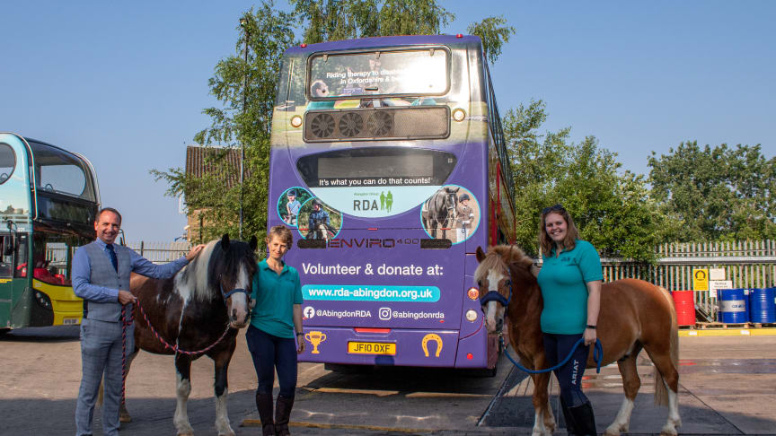 Julie Summersbee (L) and Alice Summersbee (R) and Jasper (R) and Jim-Bob (L) the ponies of Abingdon RDA with Phil Southall of Oxford Bus Company