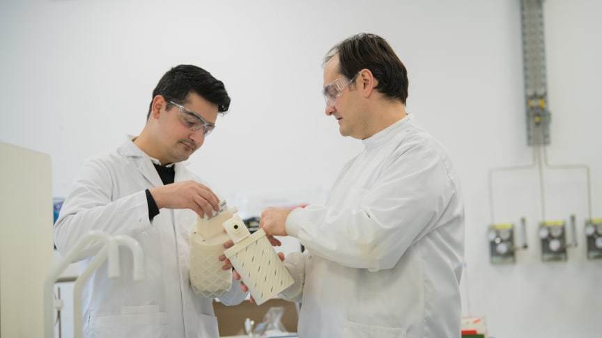 Design Engineer Saqib Ali and Dr Sterghios Moschos look at a prototype of the innovative breath collecting device