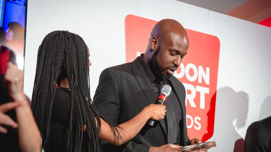 Franck Batimba receiving the Volunteer of the Year Award 2019