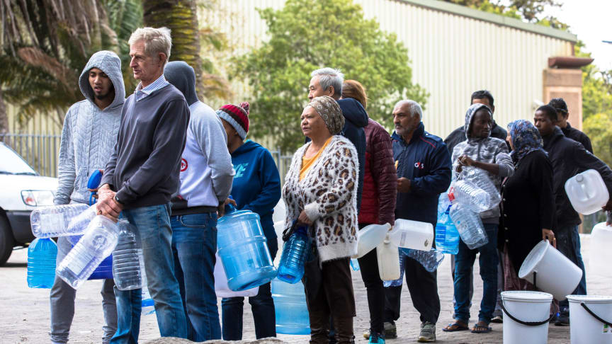 Facing urban water scarcity, Cape Town citizens line up for drinking water during the city's 2018 water crisis (Credit: Cavan / Alamy Stock Photo)
