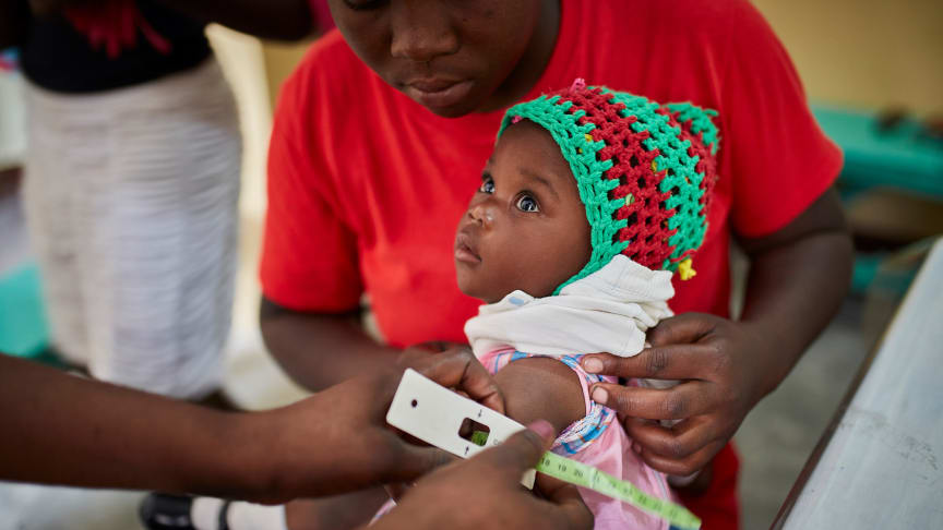 A child is screened for malnutrition in a village close to St Gerard Ti-Riviere Dupre