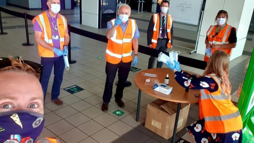 Staff at Milton Keynes station handed out face coverings during their first week of compulsory use