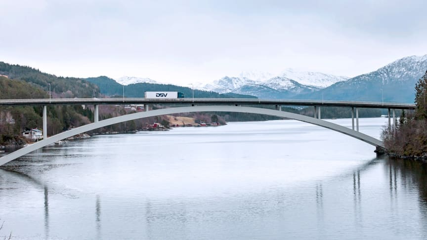 A DSV truck and trailer on its way over Skodje bridge in Norway