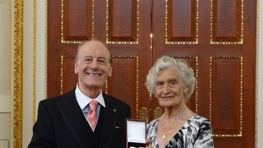 Audrey Broad receiving her 'Order of Mercy' award