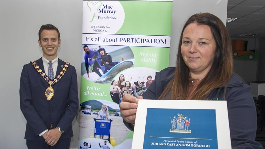 Kyleigh Lough, from the Mae Murray Foundation in Larne, receives a certificate of recognition from the Mayor on behalf of the group after they were announced winners of the Queen's Award for Voluntary Service.