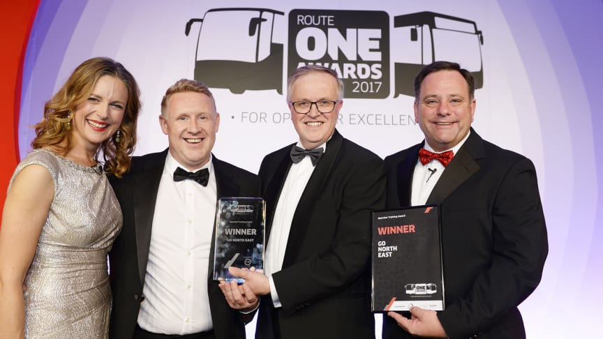L-R: routeone Awards presenter Katie Derham, Go North East's Head of Engineering Colin Barnes, Freight Transport Association Chief Executive David Wells and routeone Editor Mel Holley