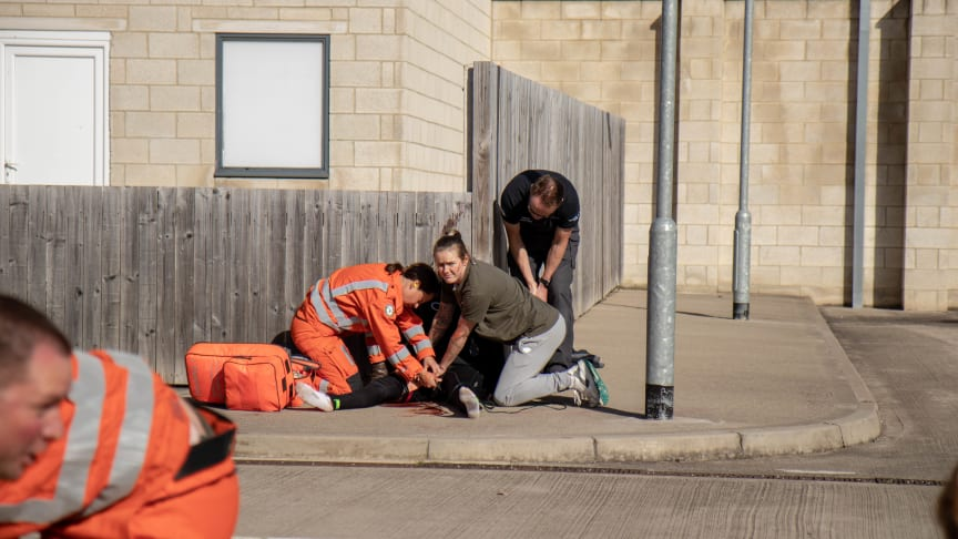 Student nurses supporting paramedics in a training exercise