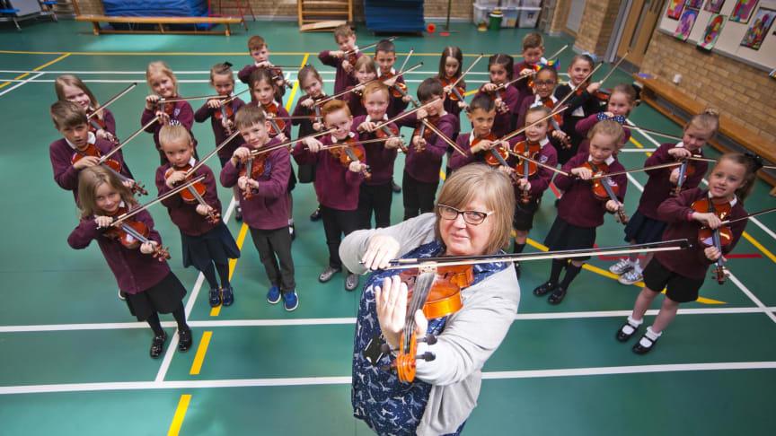 Class teacher Maureen Butterly and her P3 class
