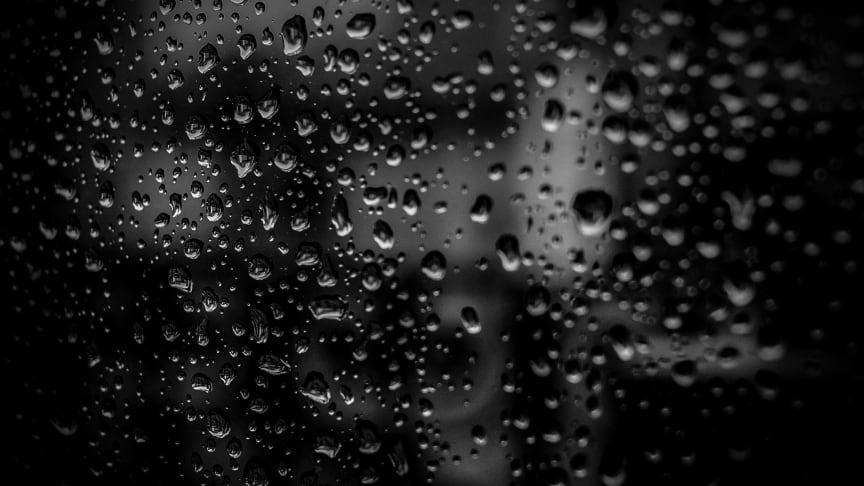 Liquid droplets on a dark surface. Credit pexels.com