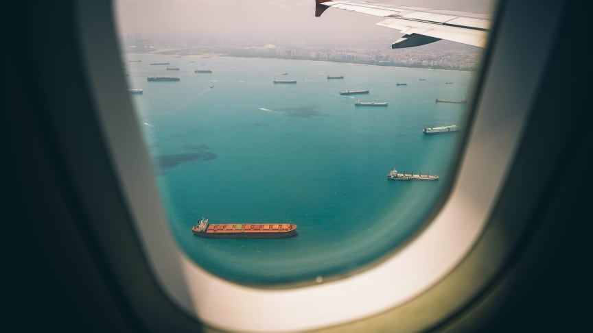Roughly 90 percent of world trade is by sea and sulfur-rich fuel powers the merchant fleet of about 95,000 vessels, including container ships. (Photo by Fancy Crave on Unsplash)