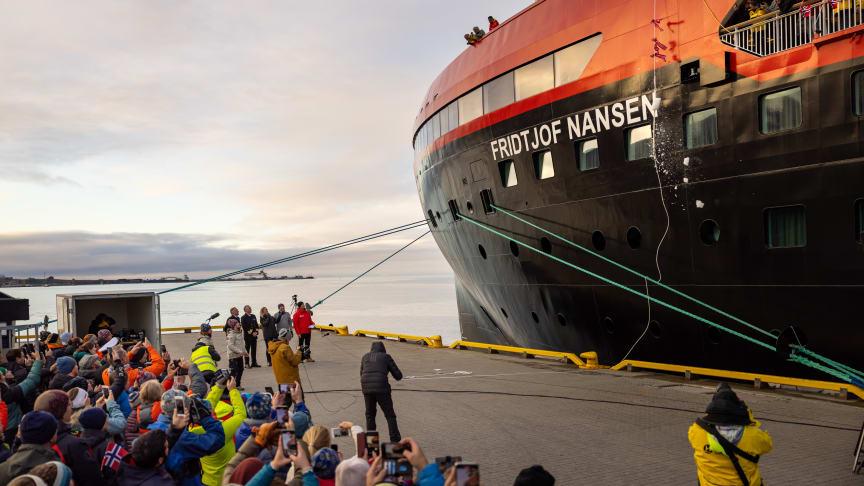 ARCTIC NAMING: Ice breaks agains the hull as battery-hybrid MS Fridtjof Nansen was named in a ceremony at home in Longyearbyen, Svalbard. PHOTO: Espen Mills/Hurtigruten Expeditions