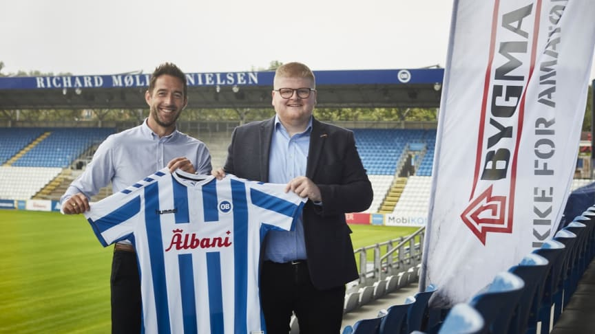 Både Claus Madsen, salgschef i Odense Sport & Event, og regionsdirektør Ejnar Andersen, Bygma, glæder sig over det nye samarbejde