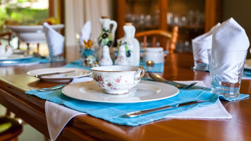 A luxurious tablecloth and pressed napkin are an important part of the dining experience.
