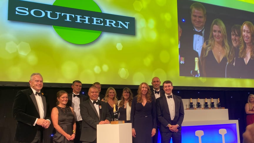Southern Managing Director Angie Doll (third from right) and her team accept the award 'Passenger Operator of the Year' from Professor Jonathan Van-Tam, Deputy Chief Medical Officer (centre), at the National Rail Awards