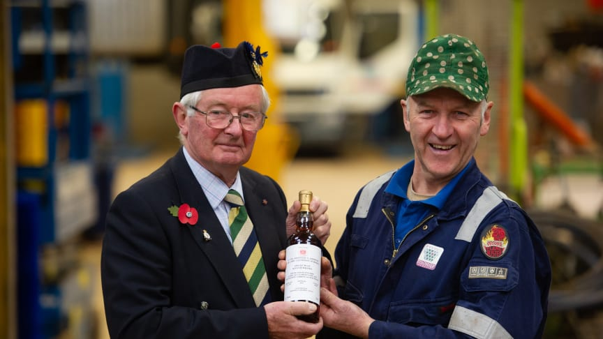 Lord Lieutenant of Moray, Grenville Johnston, gifts a special bottle of malt to blacksmith Gordon Masson as a thank you for repairing Tommy Picture courtesy of Press and Journal. P&J copyright Mo