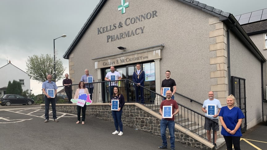 Kells & Connor Pharmacy receive their certificates of recognition from the Maupr of Mid and East Antrim, Councillor Peter Johnston.