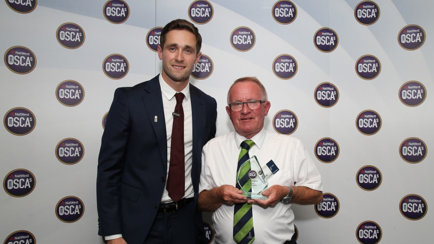 Chris Woakes presents the NatWest Lifetime Achiever OSCA to Ernie Brabbins of Appleby Eden Cricket Club at Lord's