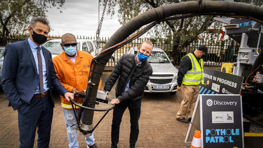 From Left to Right: Dialdirect's Bradley Du Chenne, Joburg Mayor Geoff Makhubo, and Discovery Insure Chief Executive Officer, Anton Ossip, at the launch of Pothole Patrol in Lenasia earlier today.