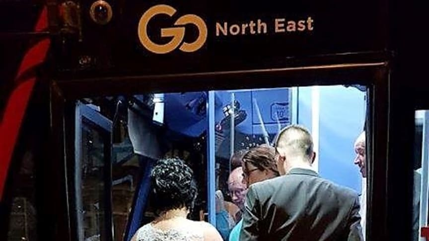 Newlyweds Kayleigh and Colin Thompson jump on-board the bus for their journey home