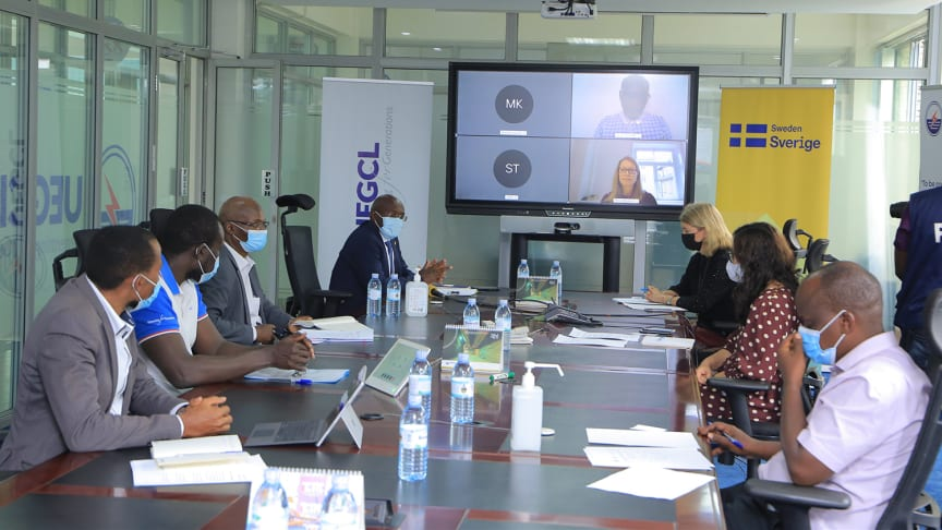 Signing ceremony in Kampala, Uganda. Swedfund participates online.