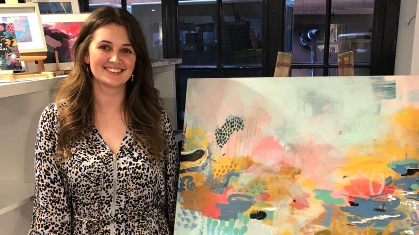 Northumbria alumna Jessica Slack with her artwork 'Finding Life's Joy'