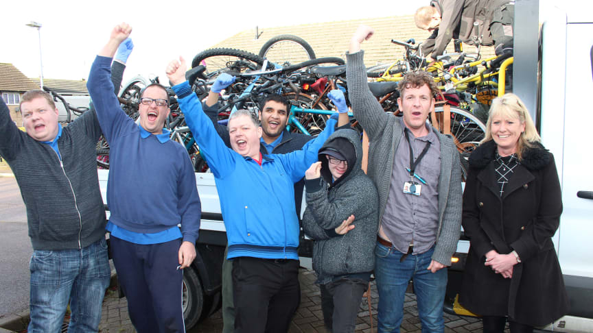 TAG Bikes Employment Skills Worker Robert Bierton (right) and members of the workshop take delivery of abandoned station bikes from GTR distribution manager Sarah Collett (far right)