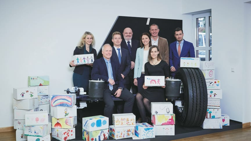 "The campaign ""Give a box, give a smile"" was spearheaded by (from left to right) Kerstin Petermann, Guido Eyer and Achim Kotz (BPW), Michael Lang (OLS), Renate Kotz (Re:Help), Kira Fink and Peter Schneider (BPW), and Navid Thielemann (OLS)."