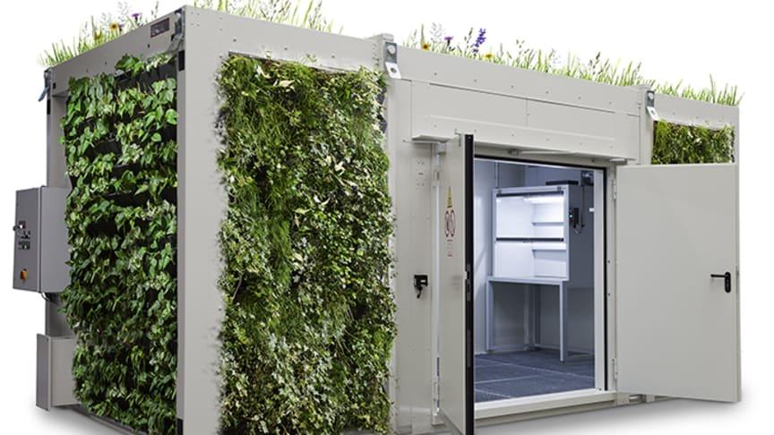 Levande gröna väggar på miljöcontainern livar upp i industrin.