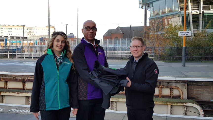 A London Northwestern Railway revenue protection officer and West Midlands Railway driver handing over old uniforms to Justin Frost from The Salvation Army Trading Company at Birmingham Snow Hill station