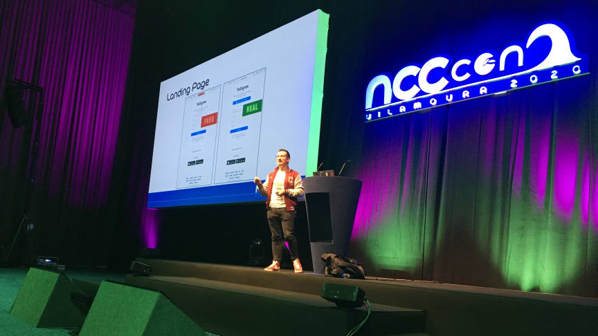 Giuseppe Trotta on stage at NCC Group's annual internal tech event - NCC Con