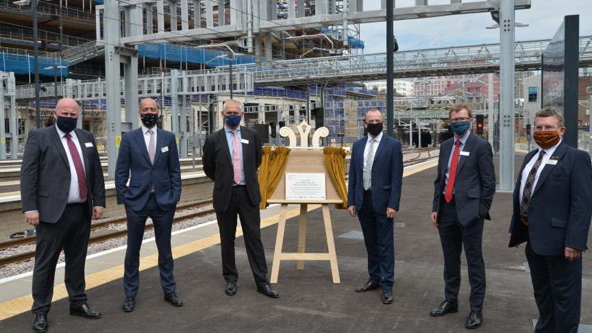 Thameslink and Great Northern MD Tom Moran (second from left) joins Network Rail's Route MD Rob Mackintosh and Rail Minister Chris Heaton-Harris (either side of the unveiled plaque) and other train company MDs at King's Cross on Monday