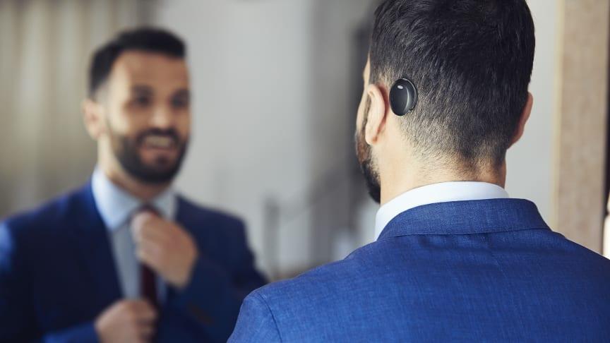 Träger mit dem neuen Cochlear™ Osia® System