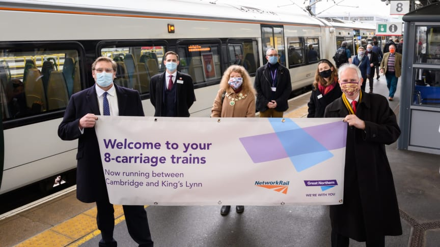 Mayor of Cambridgeshire and Peterborough Combined Authority James Palmer (left) holds a banner with Daniel Zeichner MP to celebrate the introduction of longer 8-carriage Great Northern trains between Cambridge and King's Lynn