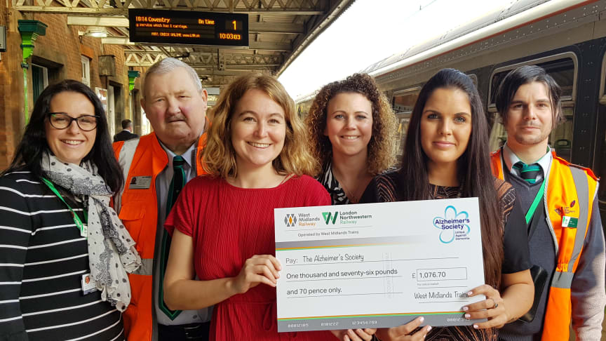 West Midlands Railway and London Northwestern Railway staff hand over the first donation of lost property money to Alzheimer's Society at Nuneaton station